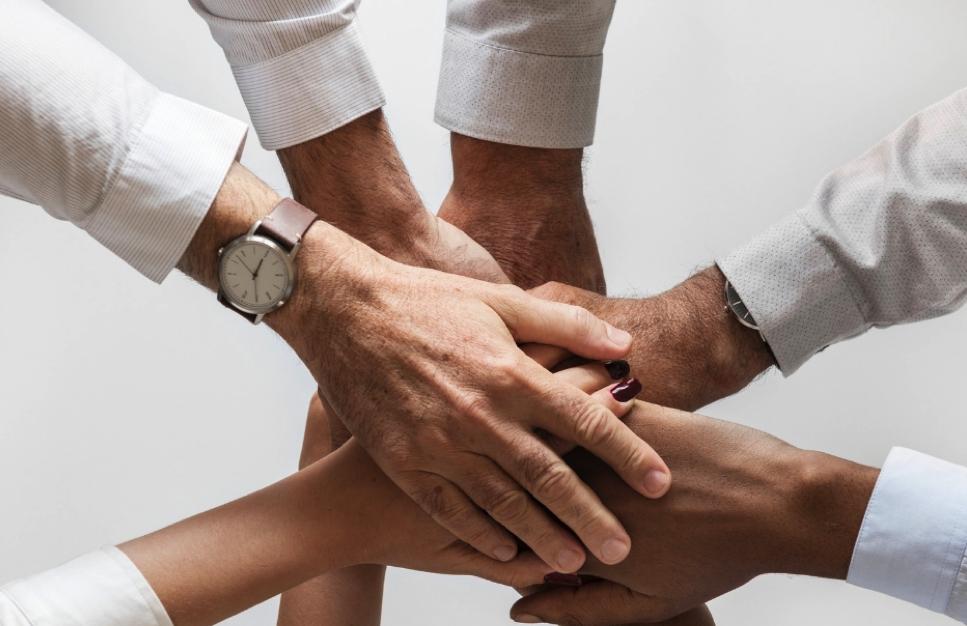 Hands held in partnership